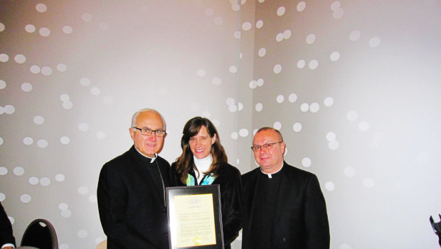 Mayor Zimmer (center) presents a proclamation to Bishop Thomas A Donato (left) along with Msgr. Robert S. Meyer (right))