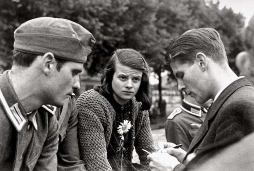 Sophie Scholl (center) with her brother Hans (left) and friend Christoph Probst (right)—founders of the White Rose Movement.
