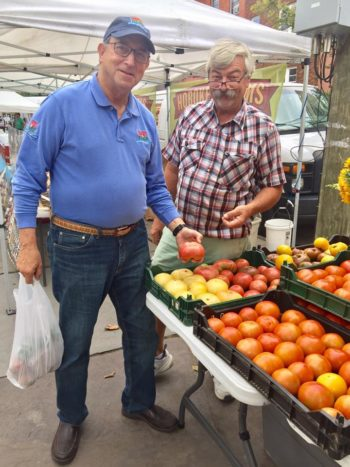 New Jersey Secretary of Agriculture, Douglas Fisher (left) with Lou from Circle Brook Farm. Photo courtesy of the Hoboken Farmers' Market.