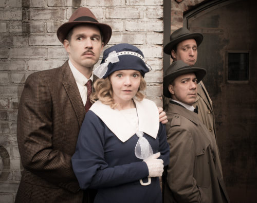 Mile Square Theatre's production of The 39 Steps, with (L to R) Joe Delafield, Alycia Kunkle, Evan Zes, and Zachary Fine. Photo by Craig Wallace Dale.